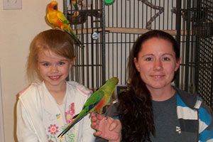 Sun conure and Sunday conure with their new family