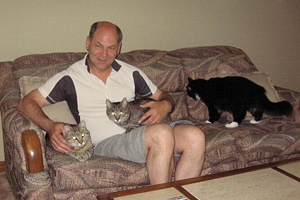 Brad with his three FIV-positive cats