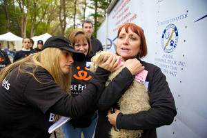 Volunteer Marti Wheat holding a dog at a Best Friends event