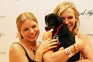 Two women holding their adopted dog