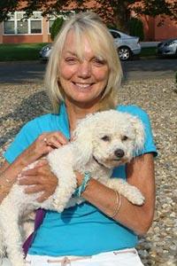 Lynn McClaren and her bichon frise dog named Cooper