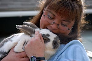 Bunny getting snuggles from a woman