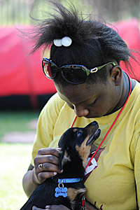 African American girl holding a small dog