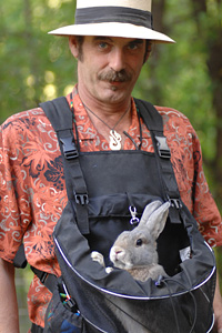 Man taking a rabbit for a walk in frontal backpack