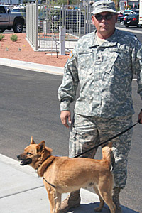 Military veteran Ted Martello walking service dog Buster