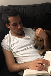 Chance the German shepherd mix who had training for fear aggression snuggling on the couch