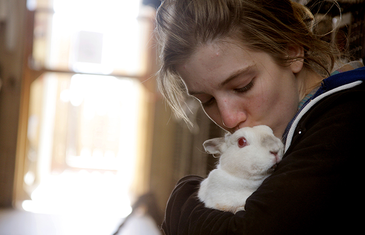 Best Friends Day 2016: woman holding rabbit