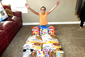 Preteen Danica's birthday pet food and treat donation for the dogs at Best Friends ANimal Sanctuary