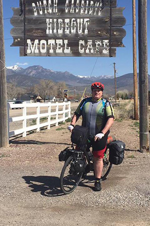Kevin McCall cycling by Butch Cassidy's Hideout Motel Cafe