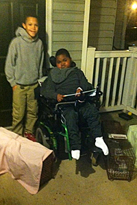 Josh and Louis who has muscular dystrophy with humane cat traps