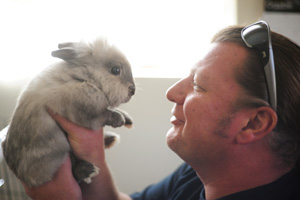 Meriwether the dwarf Lionhead rabbit with Jason Dickman the Bunny House manager