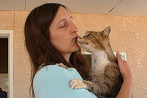 Kay with Wolfie the cat
