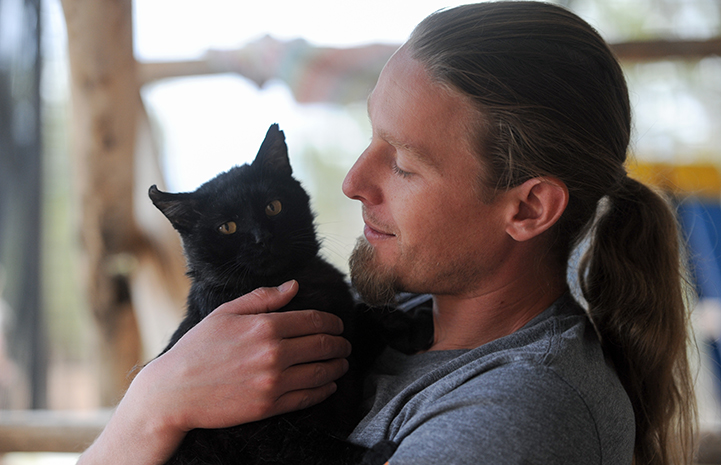 Levi Myers with Parker the cat
