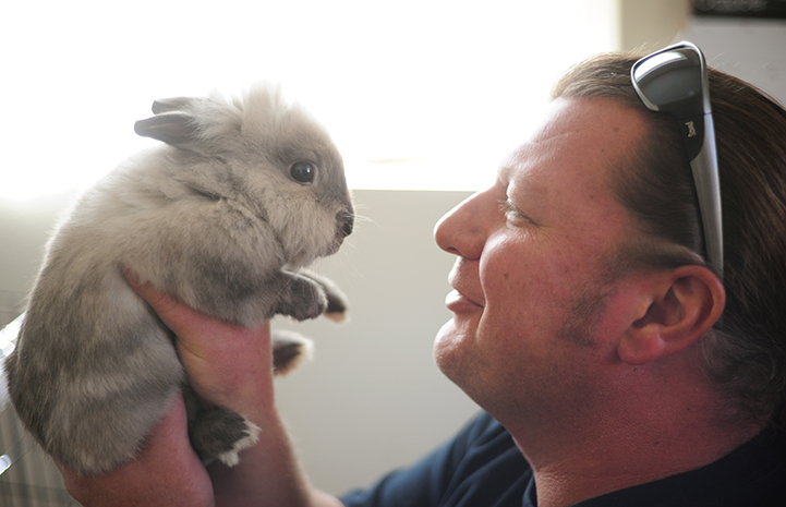 Jason Dickman with Meriwether the rabbit