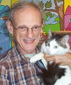 Evan Kalik, founder of Cat Adoption Team in Sherwood, Oregon, holding a cat