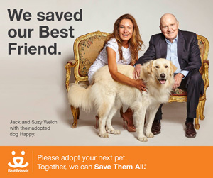 Jack and Suzy Welch with their adopted dog Happy