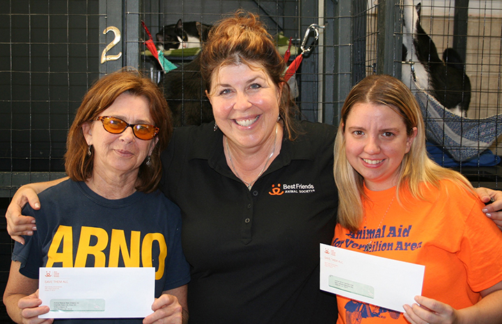 Patty Hegwood presenting checks to No More Homeless Pets Network partner groups in Louisiana