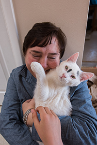 Christina Zimmer snuggling with Cookie the miracle kitten