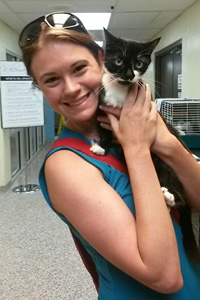 Lemonade the cat (pictured here with her new mom) is among 99 adult cats and 131 kittens who found homes
