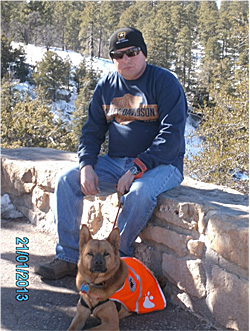 Ted Martello, a disabled veteran, with his Canines With Careers dog