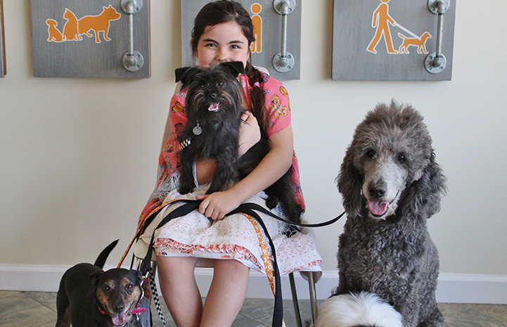 Eden with her adopted dogs, including Stormy