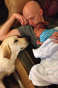 Therapy dog with man and baby