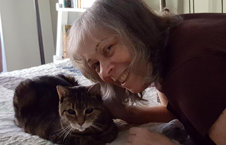 Volunteer Arlene Dolinko with a cat