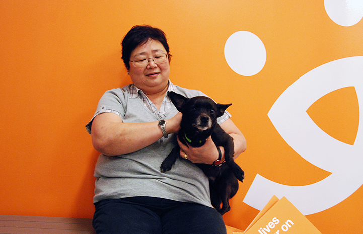 Volunteer Betty-Geargeorua with a dog at Best Friends–Atlanta