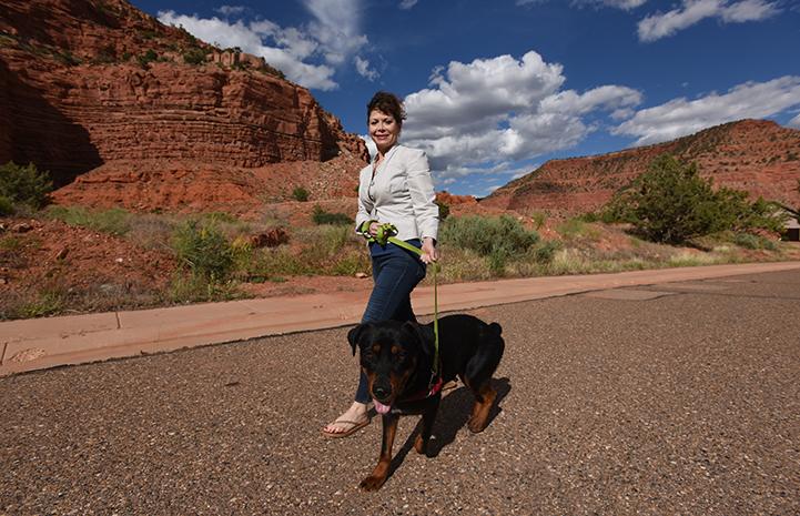 Caryn Rosenthal and Mac the dog taking a walk