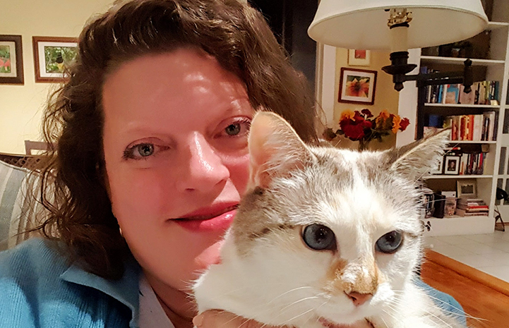 Google employee Karin Magnuson holding one of her cats