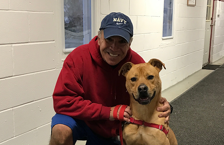 Volunteer Peter Vega with Tyler the dog
