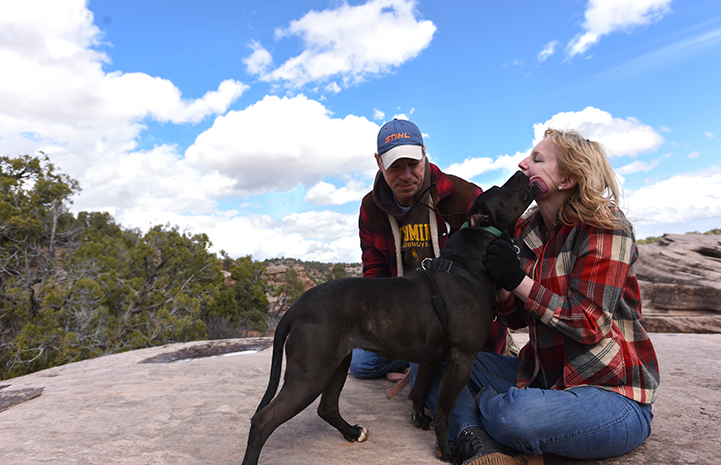 Jody Peterson and her husband with Geneva the dog