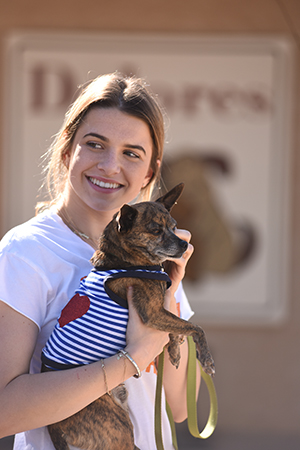 Teenager Katie McEvoy holding a small dog at Dogtown
