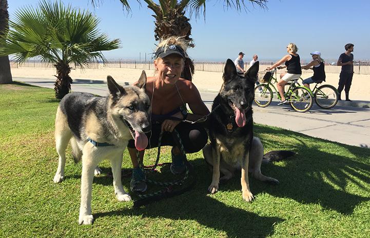 Volunteer dog walker Lotta Nilsson-May on a dog walk at the beach