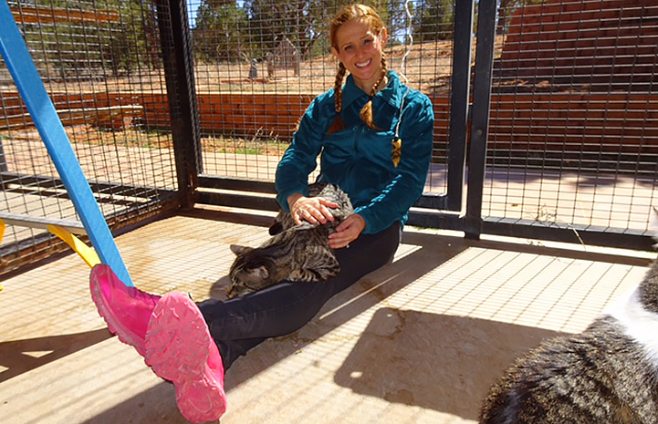 Edina Ivens enjoying her volunteer vacation at Cat World at Best Friends Animal Sanctuary