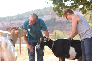 Valerie Andres and Andy Sontoski with Dreama and Cupid the goats
