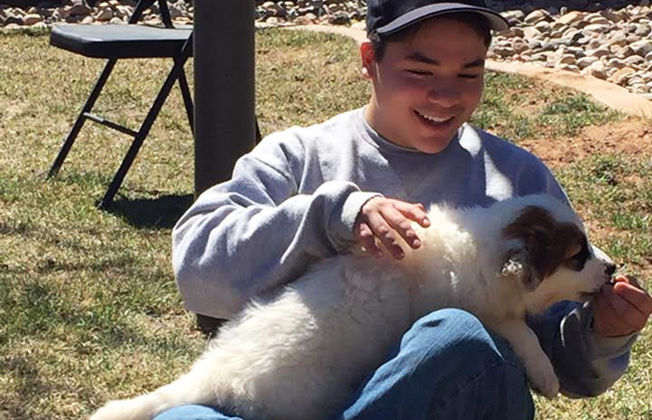 One of the Concord Academy student volunteers gets some puppy love