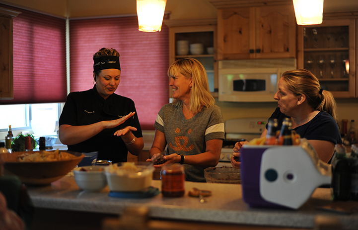 Chef Mindy giving a vegan cooking demonstration