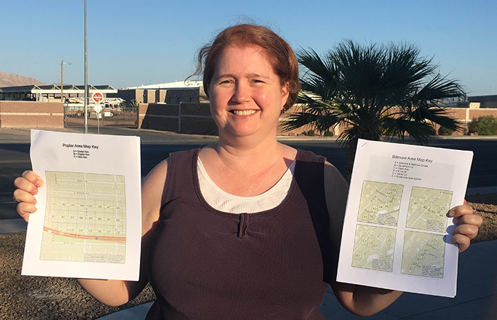 Volunteer Cheryl Collins holding some maps