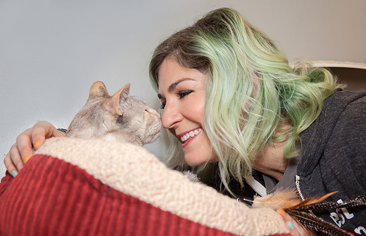 Samantha Bell DiGenova snuggling with a cat
