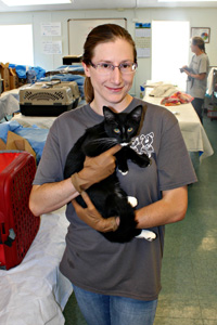 Dr. Carolyn Kenski, Best Friends community cat project coordinator, holding a cat who was spayed as part of TNR effort in Tucson, Arizona