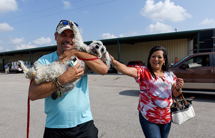 Miguel and Margarita Melendez are reunited with their dog, Precious, at the Rescue and Reunite Center