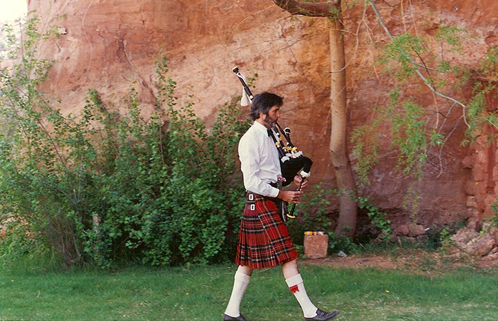 Gregory Castle playing bagpipes in Angel Canyon