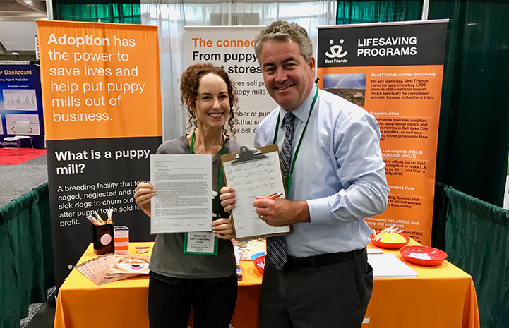 Elizabeth Oreck in front of a booth with Assembly member O'Donnell