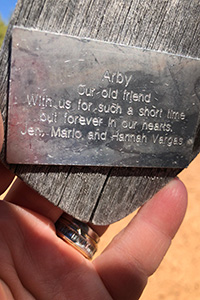 Engraving on wind chime memorial for Arby the dog