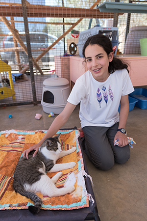 Lily Dick posing next to a cat at Best Friends Animal Sanctuary