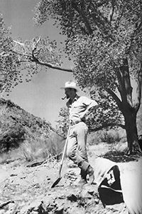 Paul Eckhoff surveying Angel Canyon leaning on a shovel