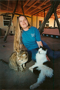 Vivian Ebbs in Cat World petting some cats