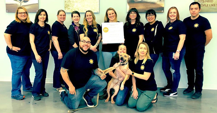 The Executive Leadership Certification graduates with a dog