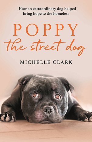 Cover of the book, 'Poppy the street dog: How an extraordinary dog helped give hope to the homeless'